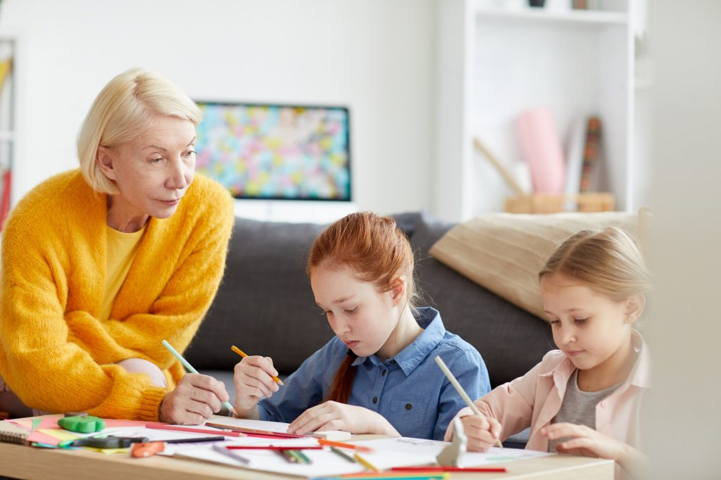 Mature Woman Drawing with two Kids