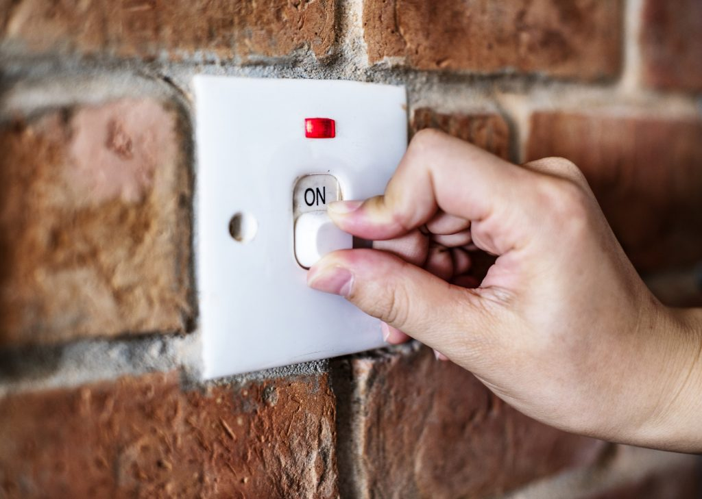 Closeup of switch on brick wall